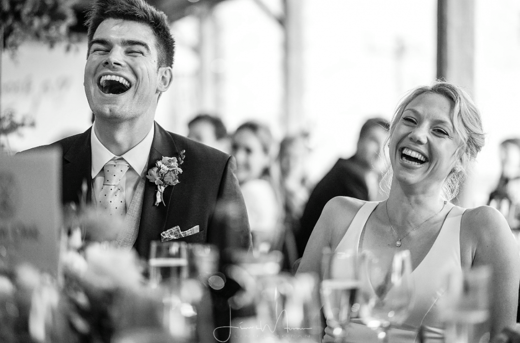 Bride styled by Bridal Hair in Hampshire laughing with groom