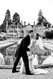 Rhinefield House bride and groom beside water