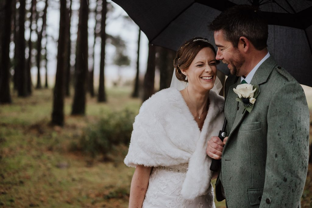 Bride and groom rainy wedding styled by Bridal Hair in Hampshire